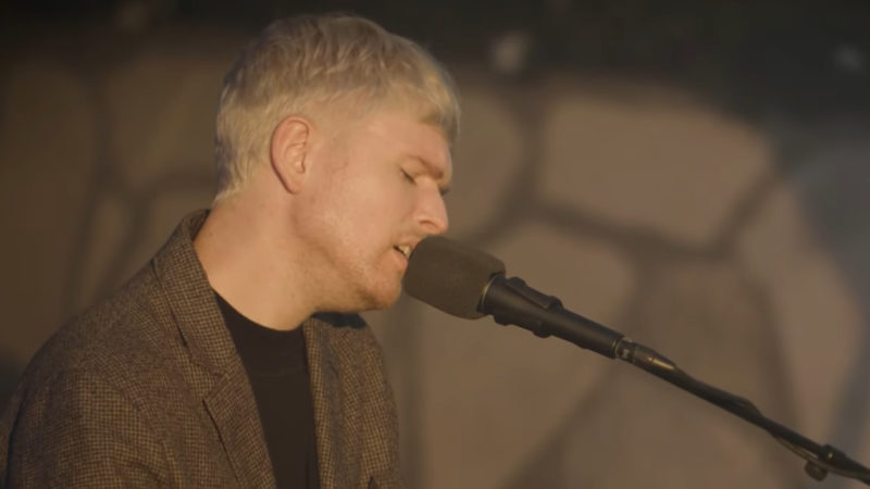 Singer James Blake performing The First Time Ever I Saw Your Face
